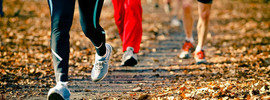 Small thumb people running in fall